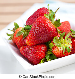 Bowl of fresh ripened and juicy strawberries.
