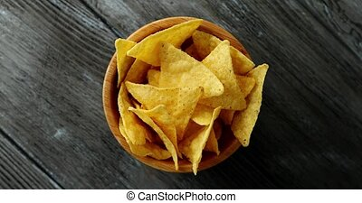Bowl of golden crispy chips - From above shot of round small...