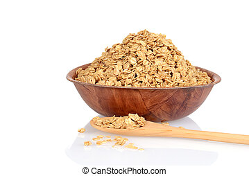 bowl of granola with wood spoon