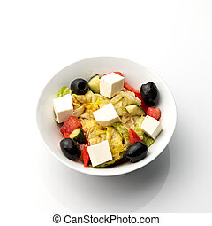 Bowl of Greek salad with feta cheese and olives. Food plate isolated on white background. Vegan or vegetarian cuisine. Top view. Appetizer dish from restaraunt menu. Exquisite served dish