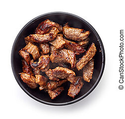 Bowl of grilled beef chunks isolated on white, from above