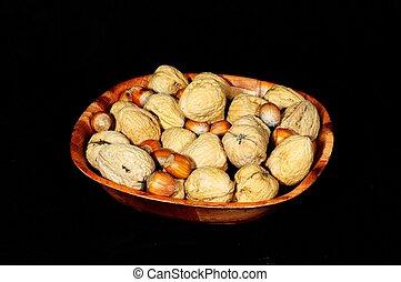 Bowl of hazelnuts and walnuts.