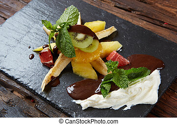 Bowl of healthy fresh fruit salad fruit with chocolate