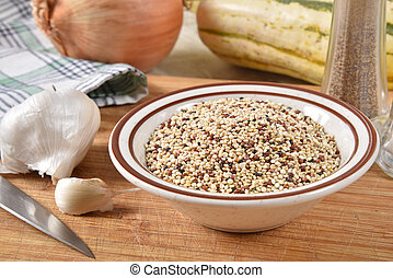 Bowl of healthy uncooked quinoa