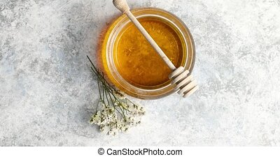 Bowl of honey with spindle - From above view of bowl full of...