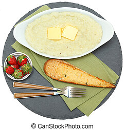 Bowl of Hot Grits with Toast and Strawberries