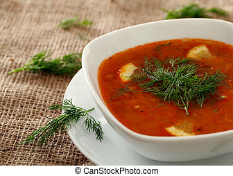 Bowl of hot red soup served with parsley