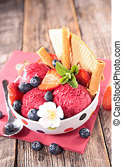 bowl of ice cream scoop with blueberry and biscuit