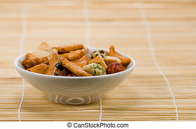 japanese rice crackers - bowl of japanese rice crackers on...