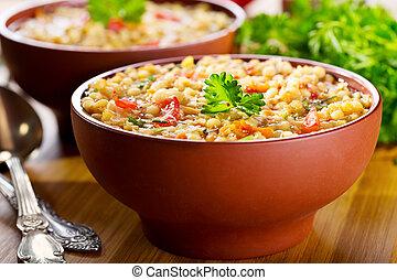 bowl of lentil soup on wooden table
