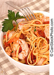 Bowl of linguine with shrimp and peppers - A bowl of...