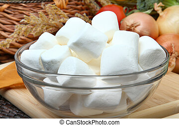 Bowl of Marshmallows - Glass bowl of white marshmallows in...