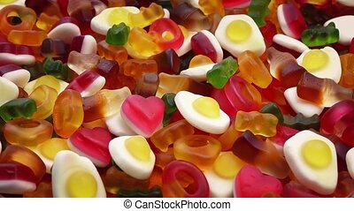Bowl Of Mixed Chewy Candies Rotating - Mixed pile of chewy...
