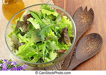 bowl of mixed salad on wooden table