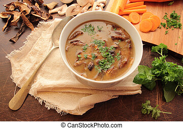 Bowl of mushroom soup with fresh parsley