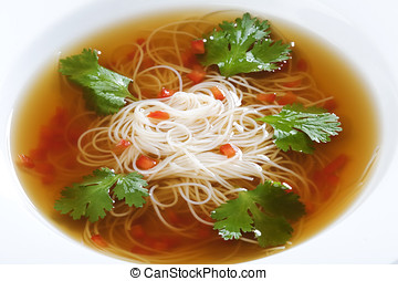 Bowl of noodle soup with beef broth and coriander
