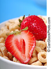Bowl of oat cereal with strawberries