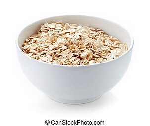 Bowl of oat flakes isolated on white
