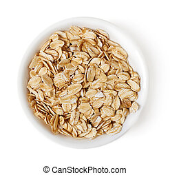 Bowl of oat flakes on white background, top view