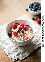 Bowl of oatmeal porridge with berries