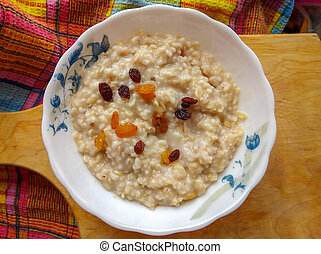 Bowl of oatmeal with raisins. Top view. breakfast