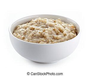 Bowl of oats porridge on a white background