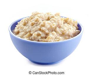 Bowl of oats porridge on a white background. Healthy...