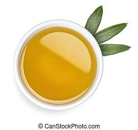 Bowl of olive oil and leaves