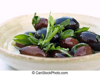 Bowl of olives - Kalamata olives and herbs in dish