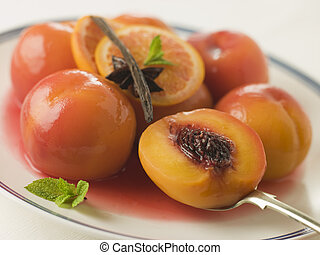 Bowl of Peaches Poached in Sauternes Wine
