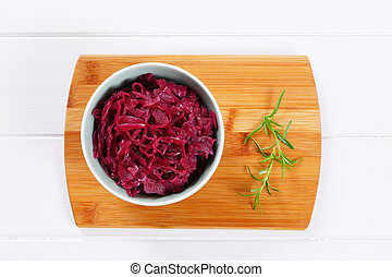 pickled red cabbage - bowl of pickled red cabbage on wooden ...