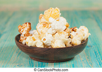 bowl of popcorn on a wooden