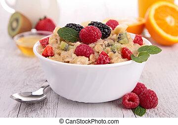 bowl of porridge and berry