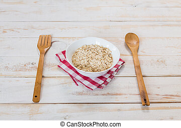 Bowl of porridge on wooden table