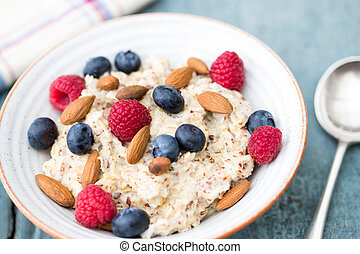 Bowl Of Porridge with Fruit And Nuts For Healthy Breakfast