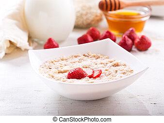 bowl of porridge with strawberry