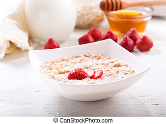 bowl of porridge with strawberry