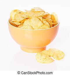 chips or crisps - bowl of potato chips or crisps...