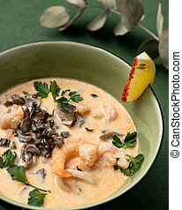 Bowl of Prawns soup. Seafood plate with Shrimp on green background. Asian cuisine concept. Template for design of restaurant menu and Web publications. Vertical format
