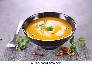 bowl of pumpkin soup and cream