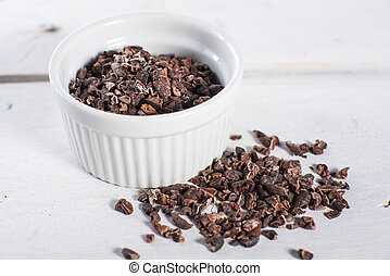 Bowl of raw cacao cocoa nibs - Bowl of chocolate cacao nibs...