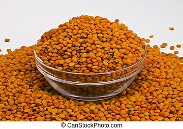 Bowl of red lentils isolated on white background
