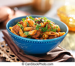 bowl of rigatoni pasta with sausage