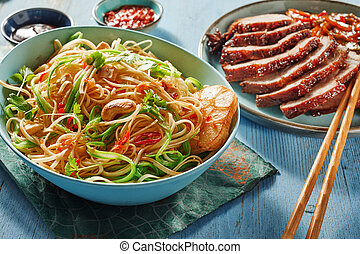 Bowl of roasted noodles and veggies with char siu