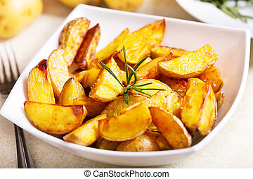 roasted potatoes with rosemary - bowl of roasted potatoes...