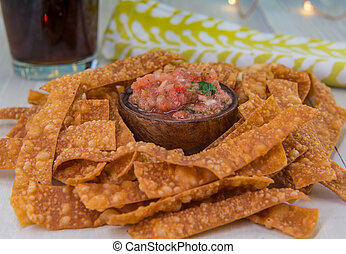 Bowl of Salsa and Chips with Napkin and Drink