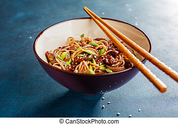 Bowl of soba noodles with beef. Asian food. Selective focus.