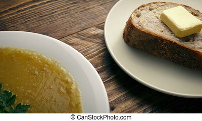 Bowl Of Soup And Bread On Wooden Table - Tracking shot...