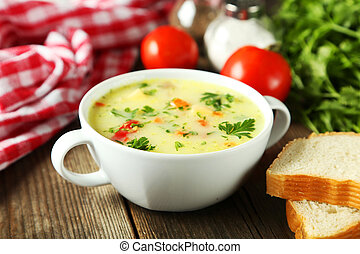 Bowl of soup on brown wooden background