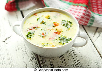 Bowl of soup on white wooden background